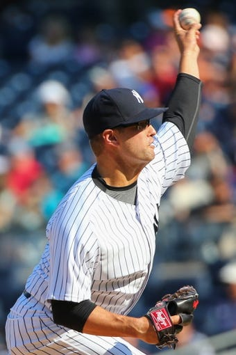 Jun 22, 2014; Bronx, NY, USA;  New York Yankees relief pitcher David Huff (55) pitches during the ninth inning against the Baltimore Orioles at Yankee Stadium. Baltimore Orioles won 8-0. Mandatory Credit: Anthony Gruppuso-USA TODAY Sports