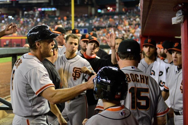Jun 22, 2014; Phoenix, AZ, USA; San Francisco Giants right fielder Hunter Pence (8) celebrates with teammates after scoring in the ninth inning against the Arizona Diamondbacks at Chase Field. Mandatory Credit: Matt Kartozian-USA TODAY Sports