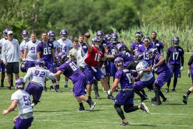 Jun 17, 2014; Eden Prairie, MN, USA; Minnesota Vikings quarterback Matt Cassel (16) throws at practice at Winter Park. Mandatory Credit: Bruce Kluckhohn-USA TODAY Sports