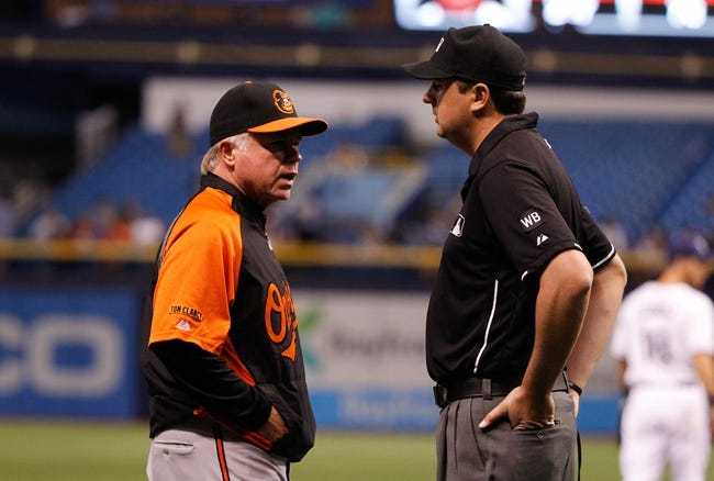 Jun 17, 2014; St. Petersburg, FL, USA; Baltimore Orioles manager Buck Showalter (26) talks with the umpire on instant replay against the Tampa Bay Rays at Tropicana Field. Mandatory Credit: Kim Klement-USA TODAY Sports