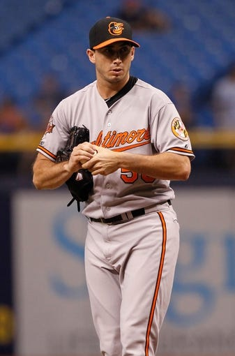 Jun 17, 2014; St. Petersburg, FL, USA; Baltimore Orioles starting pitcher Miguel Gonzalez (50) against the Tampa Bay Rays at Tropicana Field. Mandatory Credit: Kim Klement-USA TODAY Sports