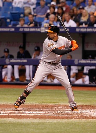 Jun 17, 2014; St. Petersburg, FL, USA; Baltimore Orioles right fielder Nick Markakis (21) at bat against the Tampa Bay Rays at Tropicana Field. Mandatory Credit: Kim Klement-USA TODAY Sports