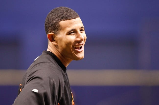 Jun 17, 2014; St. Petersburg, FL, USA; Baltimore Orioles third baseman Manny Machado (13) smiles as he works out prior to the game against the Tampa Bay Rays at Tropicana Field. Mandatory Credit: Kim Klement-USA TODAY Sports