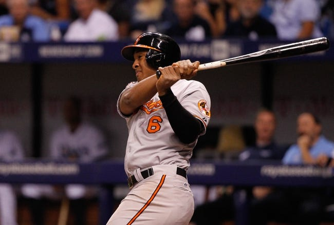 Jun 17, 2014; St. Petersburg, FL, USA;  Baltimore Orioles second baseman Jonathan Schoop (6) singles during the third inning against the Tampa Bay Rays at Tropicana Field. Mandatory Credit: Kim Klement-USA TODAY Sports