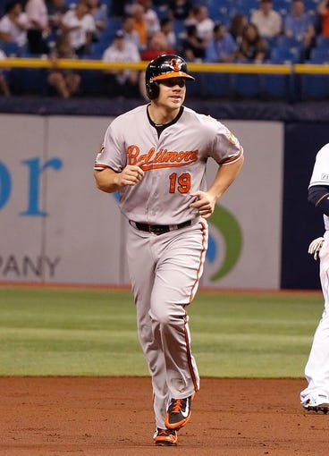 Jun 17, 2014; St. Petersburg, FL, USA; Baltimore Orioles first baseman Chris Davis (19) runs around the bases after he hit a grand slam against the Tampa Bay Rays at Tropicana Field. Mandatory Credit: Kim Klement-USA TODAY Sports