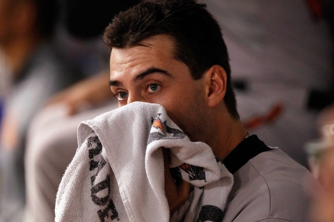 Jun 17, 2014; St. Petersburg, FL, USA; Baltimore Orioles starting pitcher Miguel Gonzalez (50) in the dugout against the Tampa Bay Rays at Tropicana Field. Mandatory Credit: Kim Klement-USA TODAY Sports