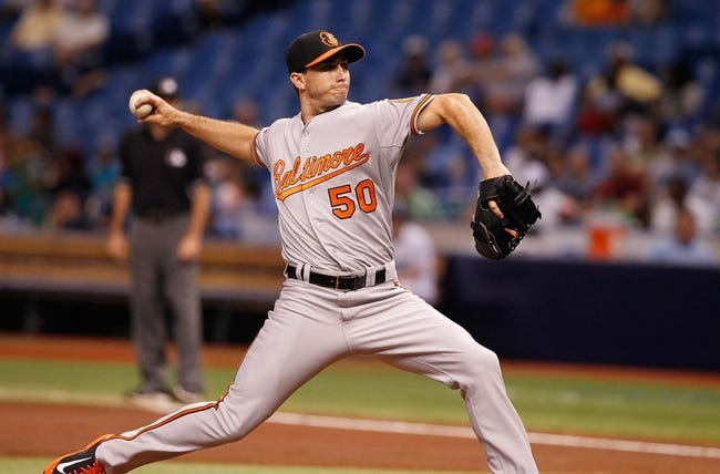 Jun 17, 2014; St. Petersburg, FL, USA; Baltimore Orioles starting pitcher Miguel Gonzalez (50) throws a pitch during the second inning against the Tampa Bay Rays at Tropicana Field. Mandatory Credit: Kim Klement-USA TODAY Sports