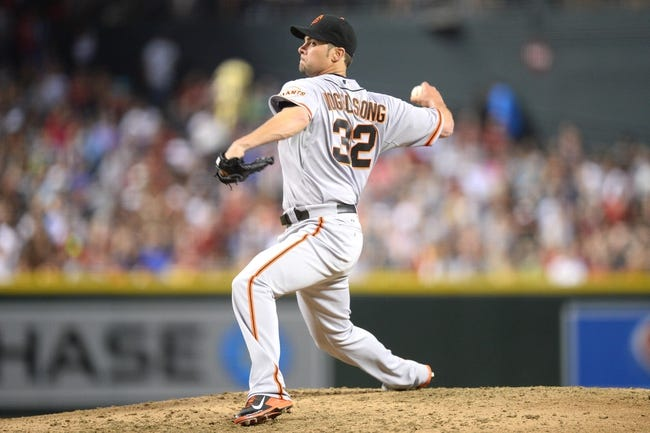 Jun 21, 2014; Phoenix, AZ, USA; San Francisco Giants starting pitcher Ryan Vogelsong (32) pitches against the Arizona Diamondbacks at Chase Field. The Giants won 6-4. Mandatory Credit: Joe Camporeale-USA TODAY Sports