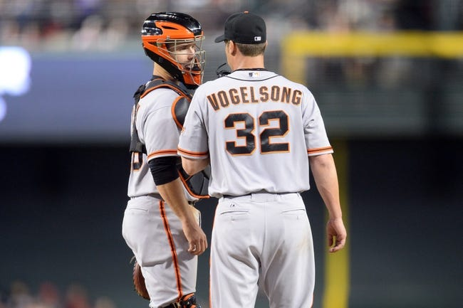 Jun 21, 2014; Phoenix, AZ, USA; San Francisco Giants catcher Buster Posey (28) talks to San Francisco Giants starting pitcher Ryan Vogelsong (32) during a timeout against the Arizona Diamondbacks at Chase Field. The Giants won 6-4. Mandatory Credit: Joe Camporeale-USA TODAY Sports