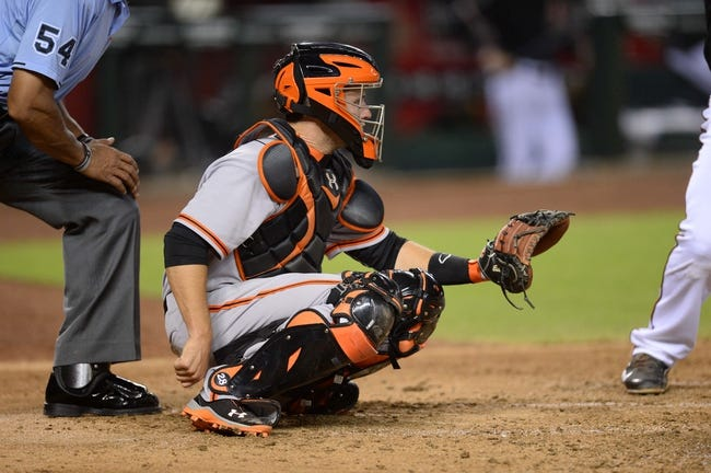 Jun 21, 2014; Phoenix, AZ, USA; San Francisco Giants catcher Buster Posey (28) defends against the Arizona Diamondbacks at Chase Field. The Giants won 6-4. Mandatory Credit: Joe Camporeale-USA TODAY Sports