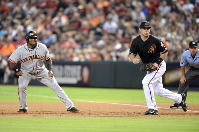 Jun 21, 2014; Phoenix, AZ, USA; San Francisco Giants third baseman Pablo Sandoval (48) leads off of first base as Arizona Diamondbacks first baseman Paul Goldschmidt (44) cover at Chase Field. The Giants won 6-4. Mandatory Credit: Joe Camporeale-USA TODAY Sports