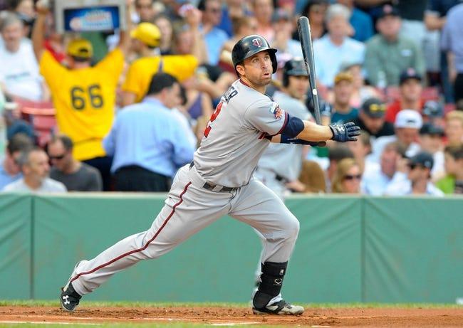 Jun 17, 2014; Boston, MA, USA; Minnesota Twins second baseman Brian Dozier (2) bats during the first inning against the Boston Red Sox at Fenway Park. Mandatory Credit: Bob DeChiara-USA TODAY Sports