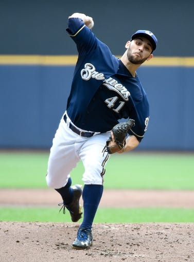 Jun 25, 2014; Milwaukee, WI, USA;  Milwaukee Brewers pitcher Marco Estrada (41) pitches in the first inning against the Washington Nationals at Miller Park. Mandatory Credit: Benny Sieu-USA TODAY Sports
