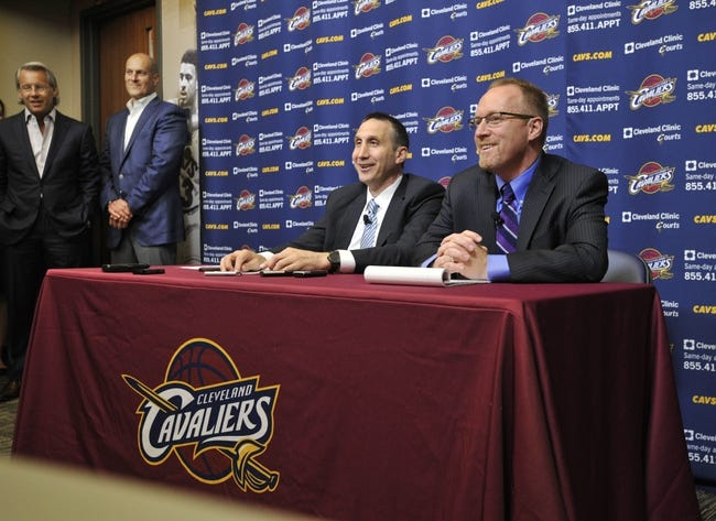 Jun 25, 2014; Independence, OH, USA; Cleveland Cavaliers managing partner Nate Forbes (left) and vice chairman Jeff Cohen (second from left) listen as head coach David Blatt (second from right) and general manager David Griffin speak to the media at Cleveland Clinic Courts. Mandatory Credit: David Richard-USA TODAY Sports