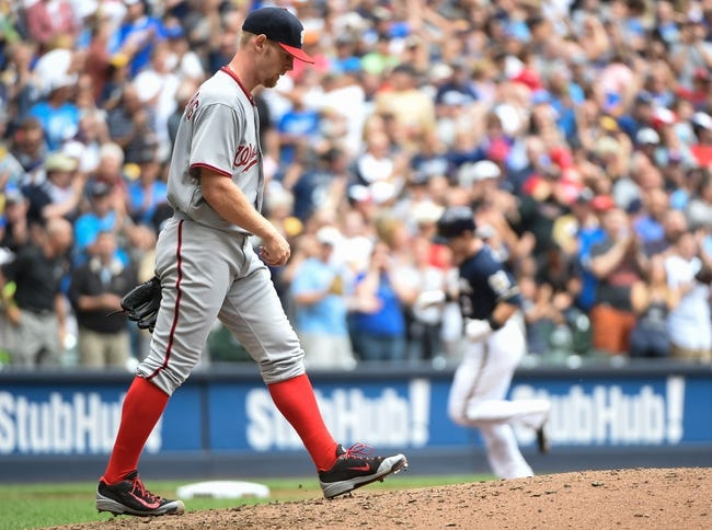 Jun 25, 2014; Milwaukee, WI, USA; Washington Nationals pitcher Stephen Strasburg (37) walks back to the mound after giving up a grand slam home run to Milwaukee Brewers second baseman Scooter Gennett (2) in the second inning at Miller Park. Mandatory Credit: Benny Sieu-USA TODAY Sports