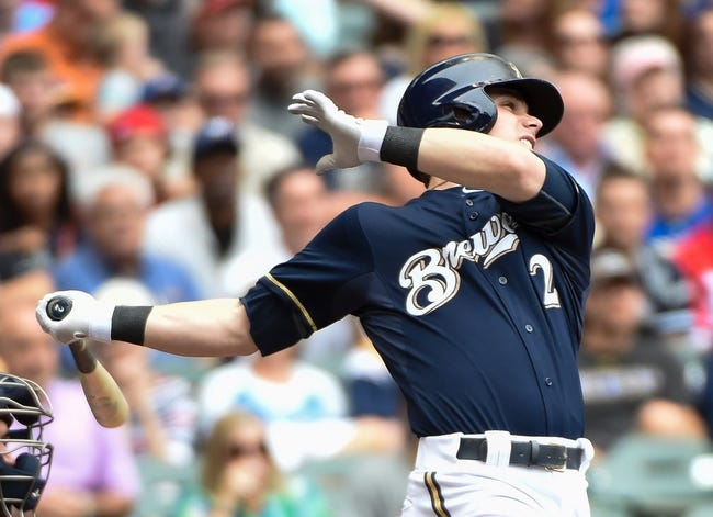 Jun 25, 2014; Milwaukee, WI, USA;  Milwaukee Brewers second baseman Scooter Gennett (2) hits a grand slam home run in the second inning against the Washington Nationals at Miller Park. Mandatory Credit: Benny Sieu-USA TODAY Sports