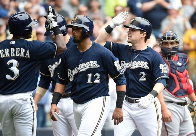 Jun 25, 2014; Milwaukee, WI, USA;  Milwaukee Brewers second baseman Scooter Gennett (2) is greeted by right fielder Elian Herrera (3) and catcher Martin Maldonado (12) after hitting a grand slam home run in the second inning at Miller Park. Mandatory Credit: Benny Sieu-USA TODAY Sports