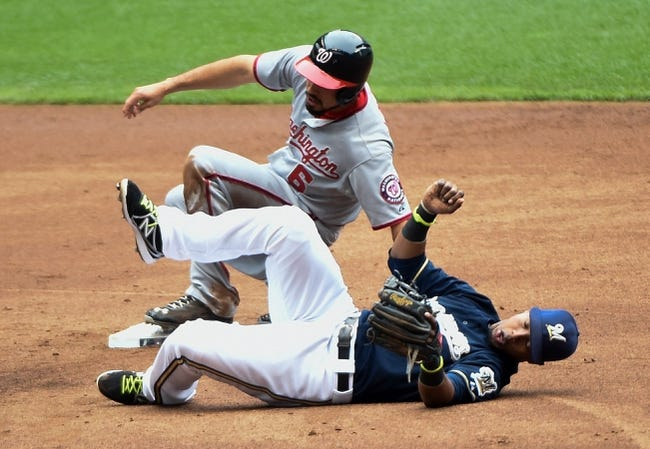 Jun 25, 2014; Milwaukee, WI, USA;  Washington Nationals third baseman Anthony Rendon (6) breaks up a double play attempt by Milwaukee Brewers shortstop Jean Segura (9) in the second inning at Miller Park. Mandatory Credit: Benny Sieu-USA TODAY Sports