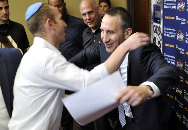 Jun 25, 2014; Independence, OH, USA; Tamir Goodman (left), a former Israeli pro basketball player, hugs Cleveland Cavaliers head coach David Blatt at Cleveland Clinic Courts. Mandatory Credit: David Richard-USA TODAY Sports