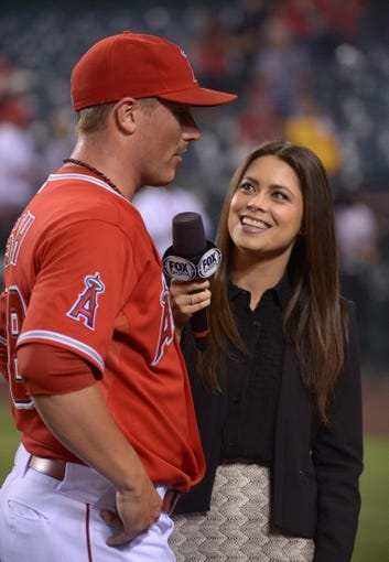 Jun 24, 2014; Anaheim, CA, USA; Fox Sports reporter Alex Curry (right) interviews Los Angeles Angels pitcher Joe Smith (38) after the game against the Minnesota Twins at Angel Stadium of Anaheim. The Angels defeated the Twins 8-6. Mandatory Credit: Kirby Lee-USA TODAY Sports