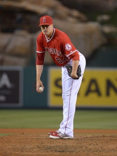 Jun 24, 2014; Anaheim, CA, USA; Los Angeles Angels reliever Mike Morin (64) delivers a pitch against the Minnesota Twins at Angel Stadium of Anaheim. The Angels defeated the Twins 8-6. Mandatory Credit: Kirby Lee-USA TODAY Sports