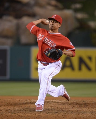 Jun 24, 2014; Anaheim, CA, USA; Los Angeles Angels reliever Ernesto Frieri (49) delivers a pitch against the Minnesota Twins at Angel Stadium of Anaheim. The Angels defeated the Twins 8-6. Mandatory Credit: Kirby Lee-USA TODAY Sports