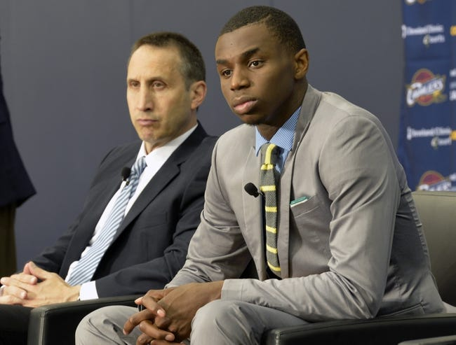 Jun 27, 2014; Independence, OH, USA; Cleveland Cavaliers head coach David Blatt (left) listens as first round pick Andrew Wiggins speaks to the media at Cleveland Clinic Courts. Mandatory Credit: David Richard-USA TODAY Sports
