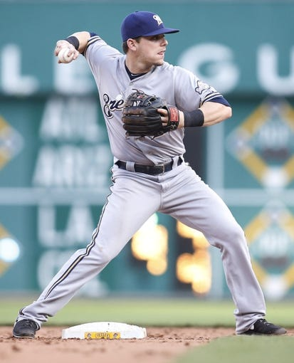 Jun 7, 2014; Pittsburgh, PA, USA; Milwaukee Brewers second baseman Scooter Gennett (2) throws to first to complete a double play against the Pittsburgh Pirates during the eighth inning at PNC Park. The Brewers won 9-3. Mandatory Credit: Charles LeClaire-USA TODAY Sports
