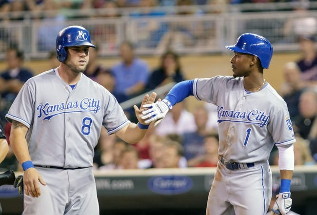 Jun 30, 2014; Minneapolis, MN, USA; Kansas City Royals center fielder Jarrod Dyson (1) congratulates third baseman Mike Moustakas (8) after scoring in the eighth inning against the Minnesota Twins at Target Field. The Kansas City Royals win 6-1. Mandatory Credit: Brad Rempel-USA TODAY Sports