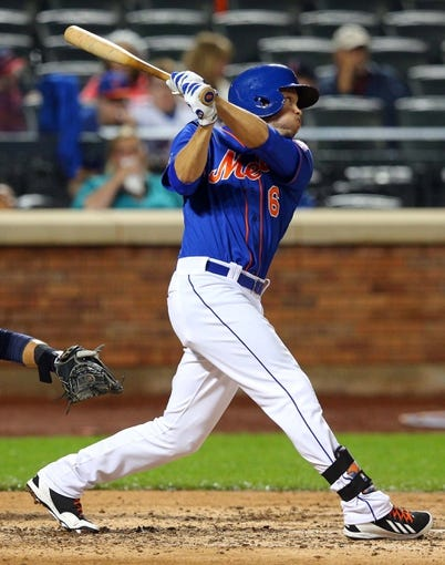 Jun 13, 2014; New York, NY, USA; New York Mets center fielder Matt den Dekker (6) hits an RBI double against the San Diego Padres during the fourth inning of a game at Citi Field. The Mets defeated the Padres 6-2. Mandatory Credit: Brad Penner-USA TODAY Sports