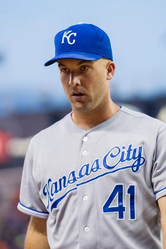 Jun 30, 2014; Minneapolis, MN, USA; Kansas City Royals starting pitcher Danny Duffy (41) walks back to the dugout against the Minnesota Twins at Target Field. Mandatory Credit: Brad Rempel-USA TODAY Sports