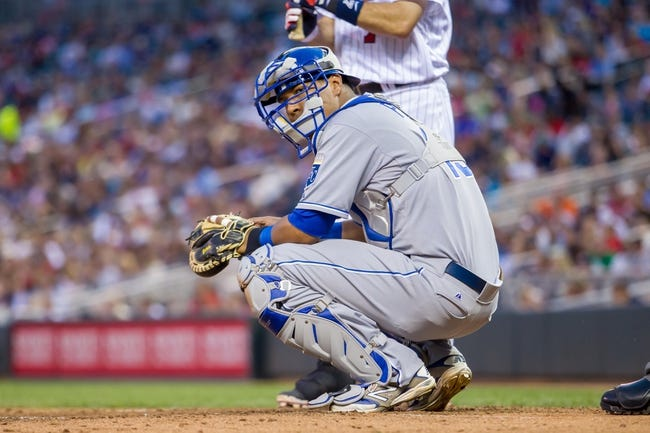 Jun 30, 2014; Minneapolis, MN, USA; Kansas City Royals catcher Salvador Perez (13) looks to his dugout against the Minnesota Twins at Target Field. Mandatory Credit: Brad Rempel-USA TODAY Sports