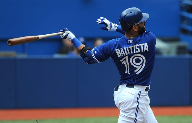 Jul 2, 2014; Toronto, Ontario, CAN;  Toronto Blue Jays designated hitter Jose Bautista connects for a home run in the first inning against Milwaukee Brewers at Rogers Centre. Mandatory Credit: Dan Hamilton-USA TODAY Sports