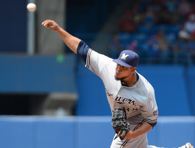 Jul 2, 2014; Toronto, Ontario, CAN; Milwzaukee Brewers starting pitcher  Wily Peralta delivers a pitch against Toronto Blue Jays at Rogers Centre. Mandatory Credit: Dan Hamilton-USA TODAY Sports
