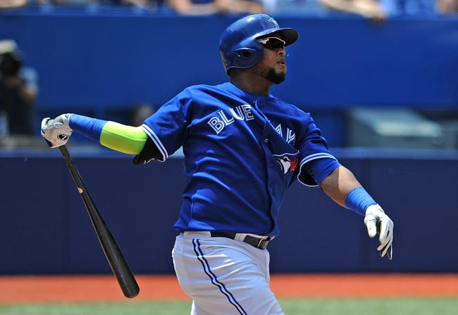 Jul 2, 2014; Toronto, Ontario, CAN; Toronto Blue Jays third baseman Juan Francisco hits a two-run home run against Milwaukee Brewers in the fourth inning at Rogers Centre. Mandatory Credit: Dan Hamilton-USA TODAY Sports