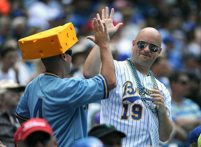 Jul 2, 2014; Toronto, Ontario, CAN;  A pair of Milwauikee Brewers fans enjoy their team's play against Toronto Blue Jays at Rogers Centre. Mandatory Credit: Dan Hamilton-USA TODAY Sports