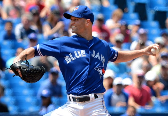 Jul 2, 2014; Toronto, Ontario, CAN;  Toronto Blue Jays starting pitcher J.A. Happ delivers a pitch against Milwaukee Brewers at Rogers Centre. Mandatory Credit: Dan Hamilton-USA TODAY Sports