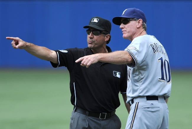 Jul 2, 2014; Toronto, Ontario, CAN; Milwaukee Brewers manager Ron Roenicke argues a call with first base umpire Phil Cuzzi earning an ejection from Wednesday's game against Toronto Blue Jays  at Rogers Centre. Mandatory Credit: Dan Hamilton-USA TODAY Sports