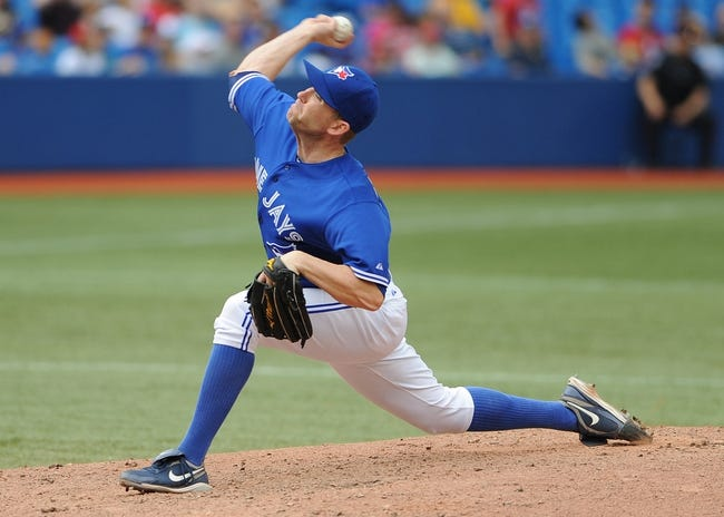 Jul 2, 2014; Toronto, Ontario, CAN; Toronto Blue Jays relief pitcher Casey Janssen delivers a pitch in the ninth inning of the Jays 7-4 win over Milwaukee Brewers at Rogers Centre. Mandatory Credit: Dan Hamilton-USA TODAY Sports
