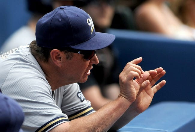 Jul 2, 2014; Toronto, Ontario, CAN; Milwaukee Brewers first base coach Garth Iorg gestures to infield players during the Brewers 7-4 loss to Toronto Blue Jays at Rogers Centre. Mandatory Credit: Dan Hamilton-USA TODAY Sports