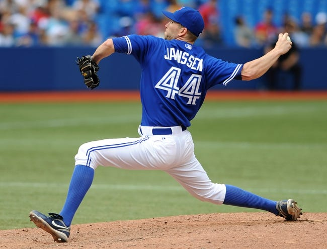 Jul 2, 2014; Toronto, Ontario, CAN;  Toronto Blue Jays relief pitcher Casey Janssen delivers a pitch in the Jays 7-4 win over Milwaukee Brewers at Rogers Centre. Mandatory Credit: Dan Hamilton-USA TODAY Sports