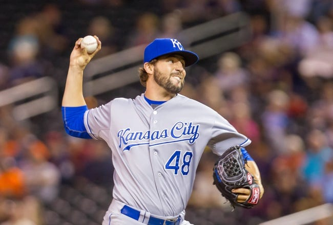 Jun 30, 2014; Minneapolis, MN, USA; Kansas City Royals relief pitcher Michael Mariot (48) pitches against the Minnesota Twins at Target Field. Mandatory Credit: Brad Rempel-USA TODAY Sports