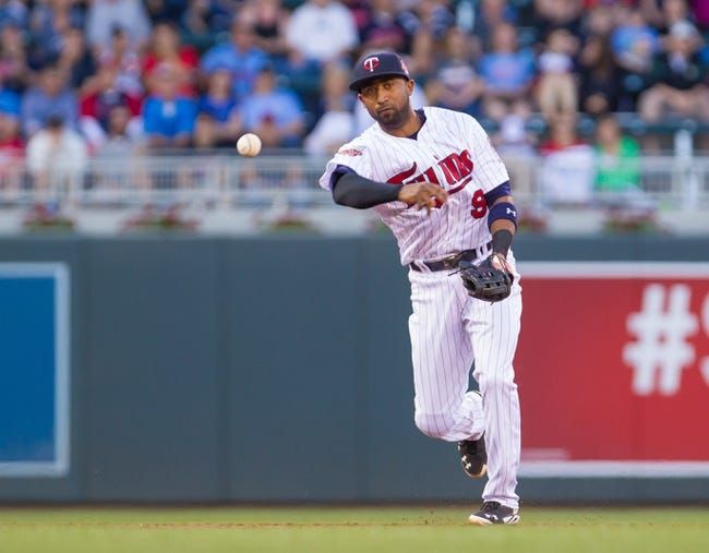 Jun 30, 2014; Minneapolis, MN, USA; Minnesota Twins shortstop Eduardo Nunez (9) throws to first against the Kansas City Royals at Target Field. Mandatory Credit: Brad Rempel-USA TODAY Sports