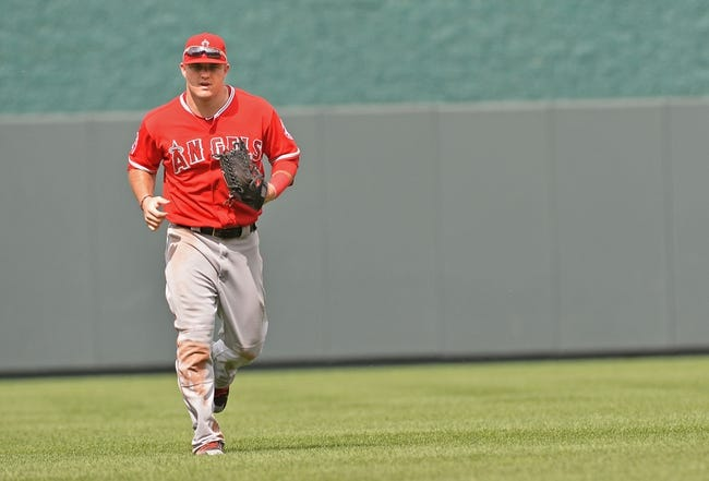 Jun 29, 2014; Kansas City, MO, USA; Los Angeles Angels center fielder Mike Trout (27) runs in from center field against the Kansas City Royals during the eighth inning at Kauffman Stadium. Mandatory Credit: Peter G. Aiken-USA TODAY Sports