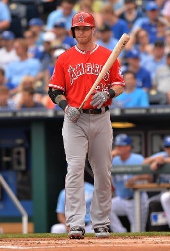 Jun 29, 2014; Kansas City, MO, USA; Los Angeles Angels left fielder Josh Hamilton (32) at bat against the Kansas City Royals during the first inning at Kauffman Stadium. Mandatory Credit: Peter G. Aiken-USA TODAY Sports