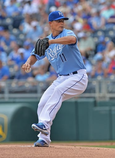 Jun 29, 2014; Kansas City, MO, USA; Kansas City Royals pitcher Jeremy Guthrie (11) delivers a pitch against the Los Angeles Angels during the first inning at Kauffman Stadium. Mandatory Credit: Peter G. Aiken-USA TODAY Sports