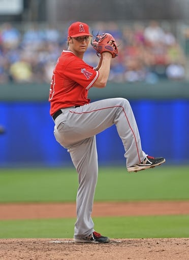 Jun 29, 2014; Kansas City, MO, USA; Los Angeles Angels pitcher C.J. Wison (33) delivers a warm up pitch against the Kansas City Royals during the first inning at Kauffman Stadium. Mandatory Credit: Peter G. Aiken-USA TODAY Sports