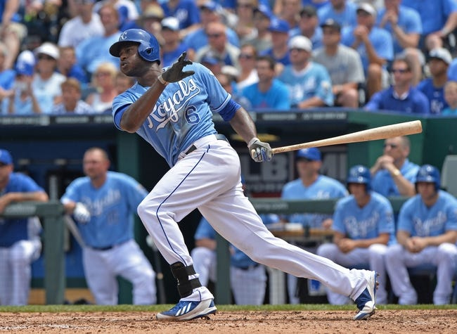 Jun 29, 2014; Kansas City, MO, USA; Kansas City Royals right fielder Lorenzo Cain (6) doubles against the Los Angeles Angels during the third inning at Kauffman Stadium. Mandatory Credit: Peter G. Aiken-USA TODAY Sports