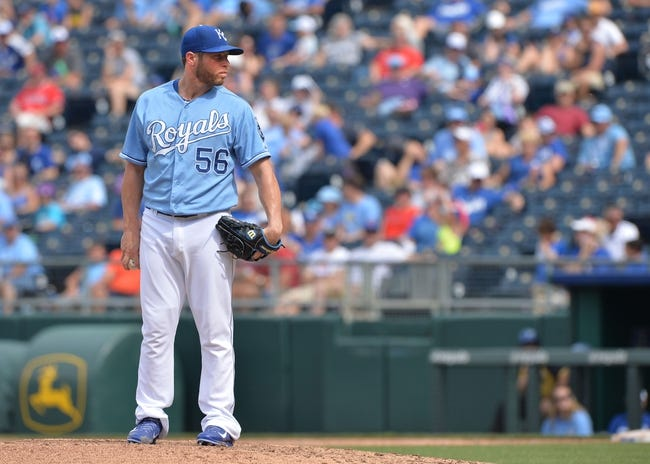 Jun 29, 2014; Kansas City, MO, USA; Kansas City Royals pitcher Greg Holland (56) looks in to home plate against the Los Angeles Angels during the ninth inning at Kauffman Stadium. Mandatory Credit: Peter G. Aiken-USA TODAY Sports