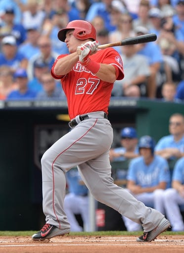 Jun 29, 2014; Kansas City, MO, USA; Los Angeles Angels center fielder Mike Trout (27) at bat against the Kansas City Royals during the first inning at Kauffman Stadium. Mandatory Credit: Peter G. Aiken-USA TODAY Sports